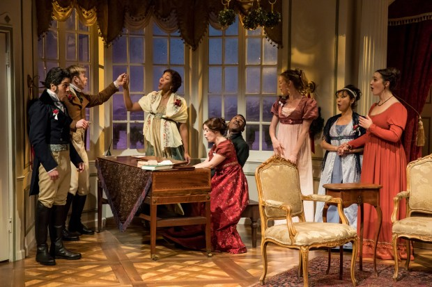 """Jungle Theater's """"Miss Bennet: Christmas at Pemberley"""" revisits Jane Austen's beloved """"Pride and Prejudice"""" characters two years after the events of the book. Pictured, from left, are James Rodríguez, Sam Bardwell, Adia Morris, Christian Bardin, JuCoby Johnson, Kelsey Didion, Sun Mee Chomet and Anna Hickey. (Dan Norman)"""