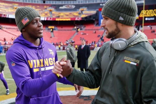 Minnesota Vikings quarterback Teddy Bridgewater (5) and Washington Redskins quarterback Kirk Cousins (8) talk before an NFL football game in Landover, Md., Sunday, Nov. 12, 2017. (AP Photo/Alex Brandon)