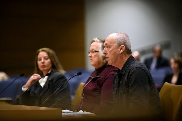 Donny Vosen, right, a private license center operator in Brainerd, Minn., testifies before a state Senate hearing on a troubled license plate computer system while Scott County Operator Julie Hanson, left, and Bloomington City Operator Kim Griffith listen at the state Capitol on Wednesday, Nov. 15, 2017. (Dave Orrick / Pioneer Press)