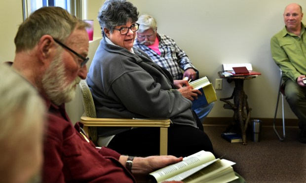 Vicki Burkhow, center, between Tom Nelson, left, and Jim Hartman, attends a meeting at Silver Sobriety in Stillwater, a non-residential recovery program that offers education, recovery services and support to adults ages 50 and older. Program director, Peter Oesterreich, is on the right. (Jean Pieri / Pioneer Press)