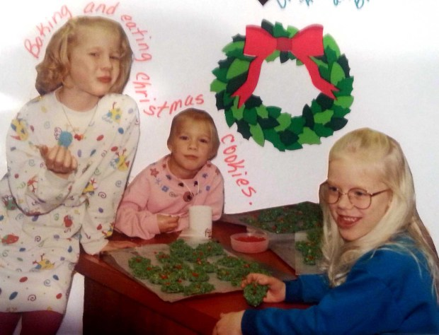 Ashley, Allie and Maddie Kelly make holiday cookies in 1992 in a photo from their mother, Barb Kelly's scrapbook. (Courtesy Ashley (Kelly) Schwartz)