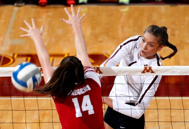 Minnesota's Jasmyn Martin, right, hits the ball during a volleyball match against Wisconsin at Maturi Pavilion in Minneapolis on Oct. 21, 2017. (Eric Miller / University of Minnesota Athletics)