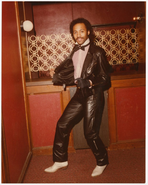 """Michael """"Chico"""" Smith in black leather and cowboy boots. (Image from """"Sights, Sounds, Soul: The Twin Cities Through the Lens of Charles Chamblis"""")"""