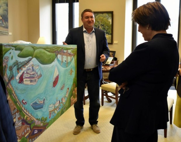 Stillwater Mayor Ted Kozlowski presents U.S. Sen. Amy Klobuchar, D-Minn., with an original oil painting of the new St. Croix River bridge and the Stillwater Lift Bridge on Nov. 14, 2017. (Courtesy of Ted Kozlowski)
