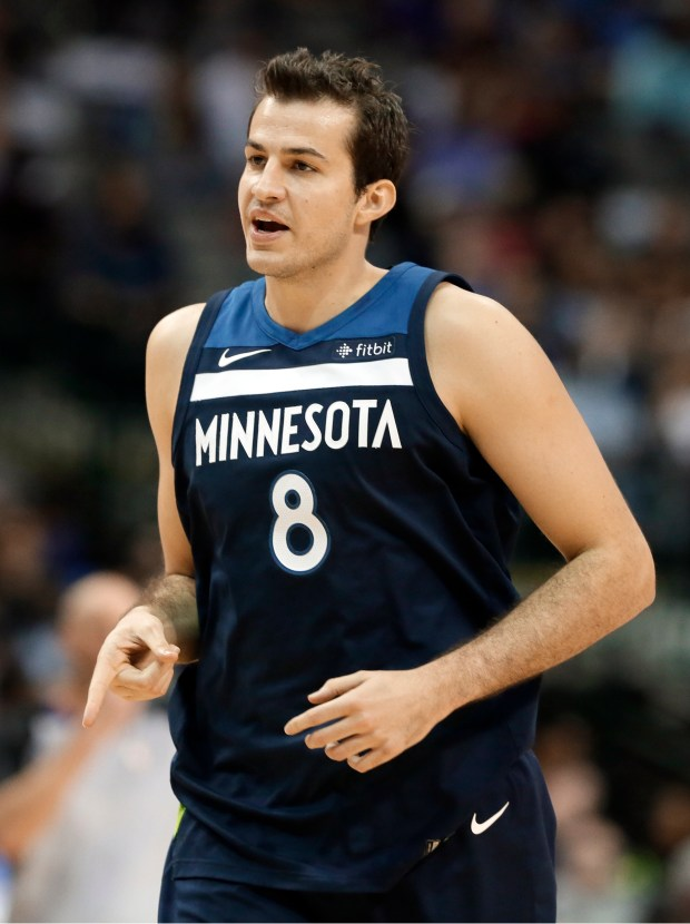 Minnesota Timberwolves forward Nemanja Bjelica (8), of Serbia, celebrates sinking a three-point basket in the second half of an NBA basketball game against the Dallas Mavericks, Friday, Nov. 17, 2017, in Dallas. (AP Photo/Tony Gutierrez)
