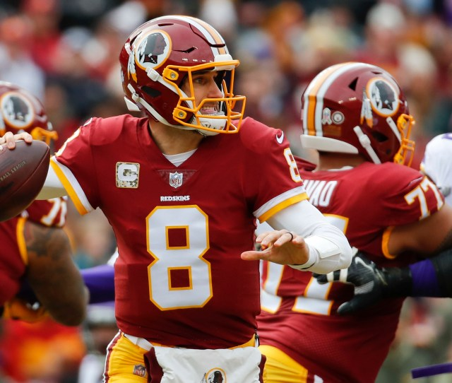 Washington Redskins Quarterback Kirk Cousins  Passes The Ball During The First Half Of An Nfl Football Game Against The Minnesota Vikings In Landover