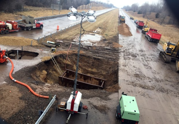 Interstate 694 in Oakdale remains closed Monday afternoon as crews work to repair a water-main break underneath the freeway on Dec. 4, 2017. (Mary Divine / Pioneer Press)