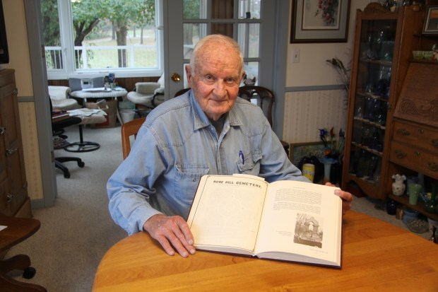 Nininger resident Harrison Benjamin contributed to a book about the town's history that describes the former Rose Hill Cemetery. (Maureen McMullen / Forum News Service)