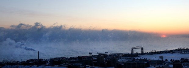 "t12.26.17 Bob King -- 122817.N.DNT.COLDc7 -- The sun rises at the edge of a band of ""sea smoke"" on Lake Superior Tuesday morning when the temperature was 19 below. Bob King / rking@duluthnews.com"