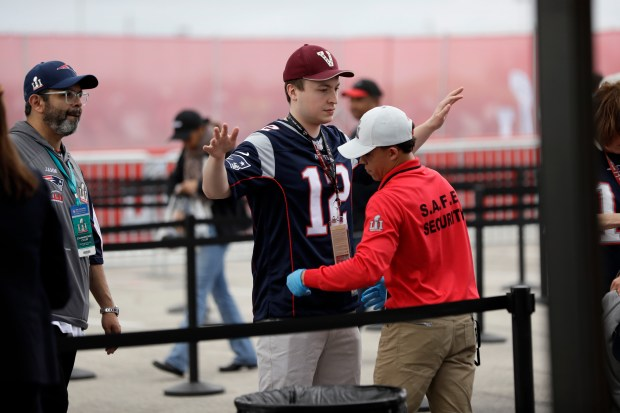 Fans are checked at a security checkpoint before the NFL Super Bowl 51 football game between the Atlanta Falcons and New England Patriots, Sunday, Feb. 5, 2017, in Houston. (AP Photo/Mark Humphrey)