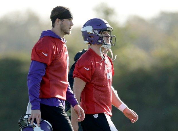 Minnesota Vikings quarterbacks Case Keenum, right, and Kyle Sloter take part in an NFL training session at the London Irish rugby team training ground in the Sunbury-onThames suburb of south west London, Friday, Oct. 27, 2017. The Minnesota Vikings are preparing for an NFL regular season game against the Cleveland Browns in London on Sunday. (AP Photo/Matt Dunham)
