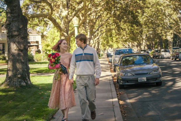 "Saoirse Ronan, left, and Lucas Hedges in a scene from ""Lady Bird."" (Merie Wallace/A24 via AP)"