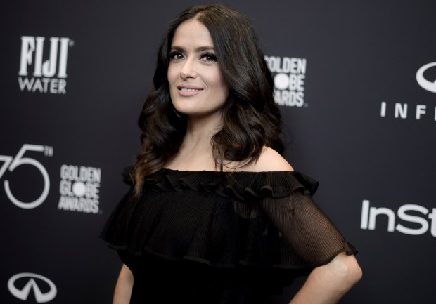 "In this Nov. 15, 2017 photo, actress Salma Hayek attends the HFPA and InStyle Celebrate the 2018 Golden Globe Awards Season in West Hollywood, Calif. In an op-ed, Hayek says that her refusals of Harvey Weinstein's advances led to a nightmare experience making the 2002 Frida Kahlo biopic ""Frida."" The New York Times on Wednesday, Dec. 13, published Hayek's account in which she wrote that Weinstein was for years ""my monster."" She said that Weinstein would turn up at her door ""at all hours of the night, hotel after hotel, location after location."" (Photo by Richard Shotwell/Invision/AP)"