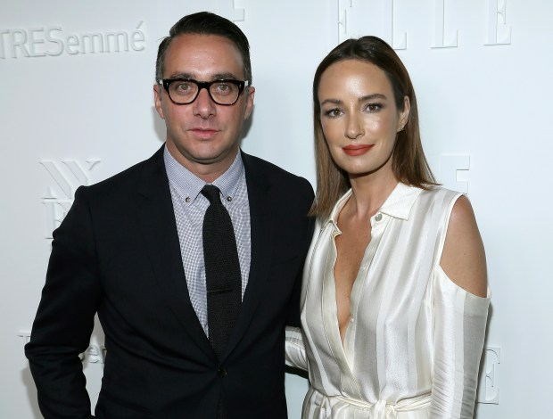 "In this Sept. 6, 2017 photo, President of E! Entertainment Adam Stotsky, left, and TV host Catt Sadler attend the ELLE, E! and IMG New York Fashion Week kick-off party in New York. Sadler, a co-host of ""Daily Pop"" on the E! Entertainment network, and said she's leaving after learning that on-air partner Jason Kennedy makes nearly twice as much money as she does. (Photo by Donald Traill/Invision/AP)"
