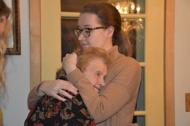 Lucy Kane hugs her grandmother, Margaret Anderson as the family mourns the passing of Lucy's mother Holly Anderson, local poet and 9/11 survivor. (Deanna Weniger/Pioneer Press)