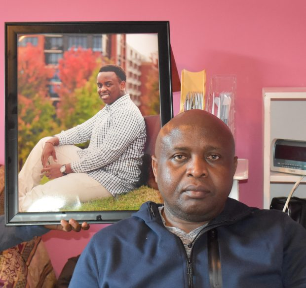 Gideon Gutwa sits in front of a portrait of his son, Griffin, on Saturday, Dec. 30, 2017. Griffin died unexpectedly Dec. 22, 2017, on a plane ride home for the holidays. (Deanna Weniger / Pioneer Press)