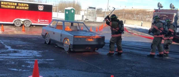 Firefighters demonstrate a car fire simulator on Thursday, Dec. 7, 2017. (Courtesy of Flint Hills Resources)