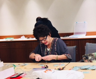 Gail Mullaney joins her peers at Securian Financial Group in St. Paul making earrings for area cancer patients. (Courtesy photo)