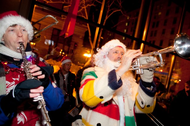 The Brass Messenger Band provides the soundtrack for SantaCon. (Photo by James Ramsay)