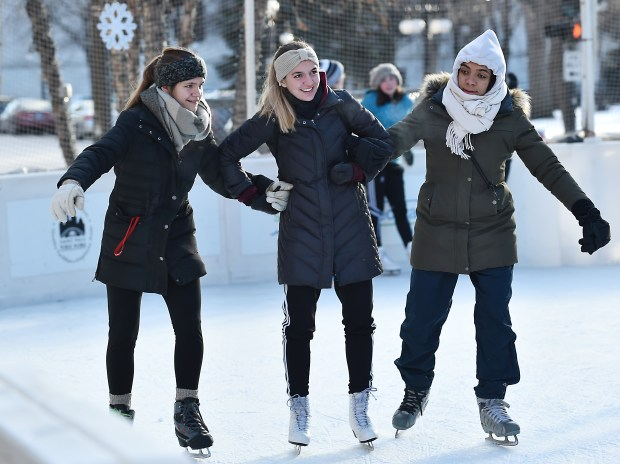 Not everyone hated the cold tempatures on Wednesday as Cousins Priscille Biehlman, from England, Domitille Biehlman from Minnesota and Marion Quercy from Canada help each other skate in the WinterSkate rink next to the Landmark Center in St. Paul, on Wednesday, Dec. 27, 2017. (Pioneer Press / John Autey)