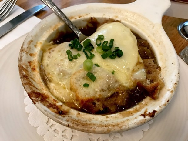 The rabbit poutine from Le Lapin Saute in Quebec City features Perron Cheddar cheese curds and two-mustard or thyme and garlic sauce. (Brian Sirimaturos/St. Louis Post-Dispatch/TNS)