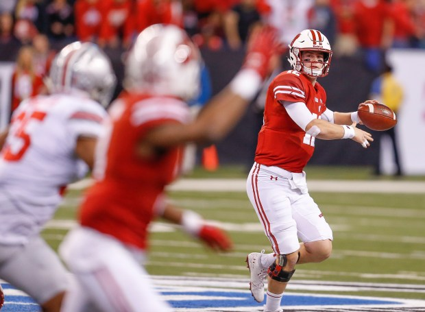 Wisconsin Badgers quarterback Alex Hornibrook (12) looks to throw as the Wisconsin Badgers take on the Ohio State Buckeyes at Lucas Oil Stadium on Saturday, Dec. 2, 2017 for the Big Ten Championship game in Indianapolis. (Sam Riche/TNS)