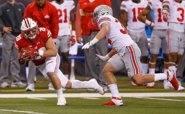 Wisconsin Badgers fullback Austin Ramesh (20) goes down on a first half run as the Wisconsin Badgers take on the Ohio State Buckeyes at Lucas Oil Stadium on Saturday, Dec. 2, 2017 for the Big Ten Championship game in Indianapolis. (Sam Riche/TNS)
