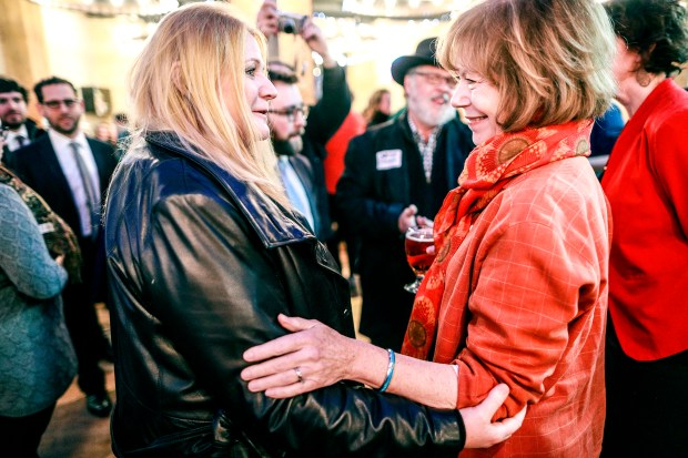 Christina St. Germaine, left, speaks with U.S. Sen. Tina Smith during a meet-and-greet hosted by Duluth Mayor Emily Larson at Hoops Brewing in Duluth on Friday evening, Jan. 5, 2018. This was Smith's first public event since becoming a senator. (Clint Austin / Forum News Service)