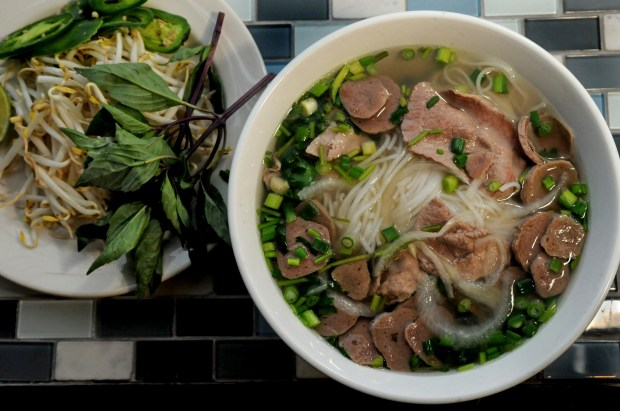 Pho Tai Bo Vien with a garnish of Thai basil, bean sprouts, jalapeno and lime at iPho Saigon in St. Paul Friday January 24, 2014. (Pioneer Press: Jean Pieri)