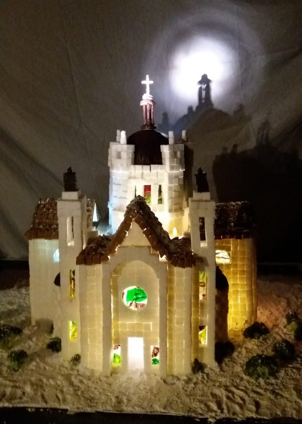 """Michelle Larson and Joanna Cahn, both of South St. Paul, made this replica Cathedral of St. Paul. They usedsugar cubes and chocolate domes and cooked their own hard-candy """"stained glass"""" for the windows."""