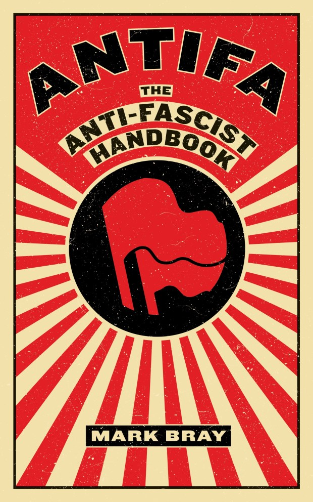 """Minnesota Rep. Keith Ellison, the deputy chairman of the Democratic National Committee, posted a photo on Twitter Wednesday of himself posing with the book """"Antifa: The Anti-Fascist Handbook."""" The book calls violence during counter-protests """"a small though vital sliver of anti-fascist activity."""""""
