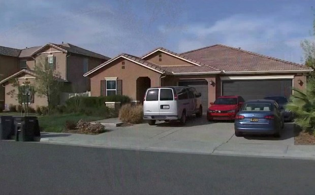 This Monday, Jan. 15, 2018, frame from video from KABC-TV shows the exterior of the home where police arrested a couple accused of holding their 13 children captive, in Perris, Calif. Authorities said an emaciated teenager led deputies to the California home where her 12 brothers and sisters were locked up in filthy conditions, with some of them malnourished and chained to beds. (KABC-TV via AP)