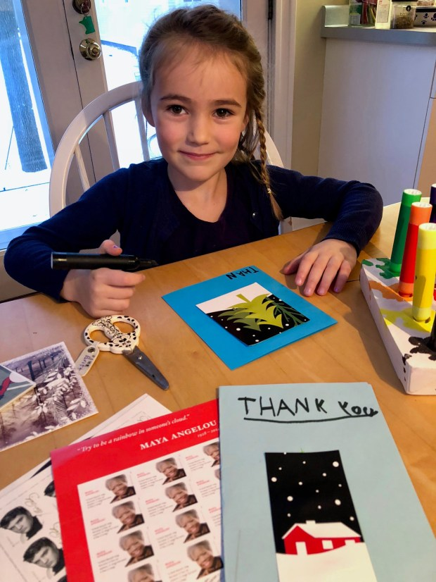 "Five-year-old Jane Richards recycles holiday cards into ""thank-you"" notes. (Courtesy of Donna Erickson)"