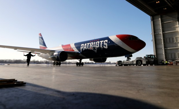 The New England Patriots' team plane is guided into a hangar as it arrives for the NFL Super Bowl 52 football game Monday, Jan. 29, 2018, in Minneapolis. New England is scheduled to face the Philadelphia Eagles Sunday. (AP Photo/Eric Gay)