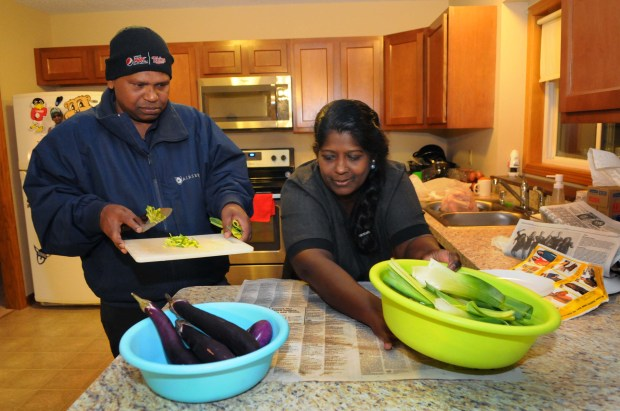 Ravindran Sivasundaram, left, and his wife, Manchuladevy Ravindran, cook dinner in the home they recently bought in Burnsville on Friday, Oct. 27, 2017. The couple and their three sons moved to the U.S. three years ago. After fleeing ethnic violence in Sri Lanka in 2006, the family lived in Kuala Lumpur, Malaysia, for eight years before coming to Minnesota.  (Ginger Pinson / Pioneer Press)