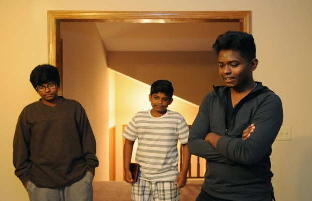 "Apilas, 13, Simraj, 16 and Kapilas, 17, came with their parents, Ravindran Sivasundaram and Manchuladevy Ravindran, to Minnesota three years ago, after fleeing ethnic violence in Sri Lanka. ""We have security and peace. ""Here, all I have to worry about is studying,"" said Kapilas. (Ginger Pinson / Pioneer Press)"