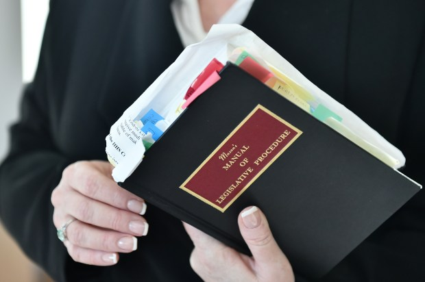 Lt. Governor Michelle L. Fischbach of Paynesville hold a copy of a much used 'Mason's Manual of Legislative Procedure' while talking to a reporter in her State Senate office in the Minnesota State Senate Office Building in St .Paul on Wednesday, Jan. 17, 2018. (Pioneer Press / John Autey)