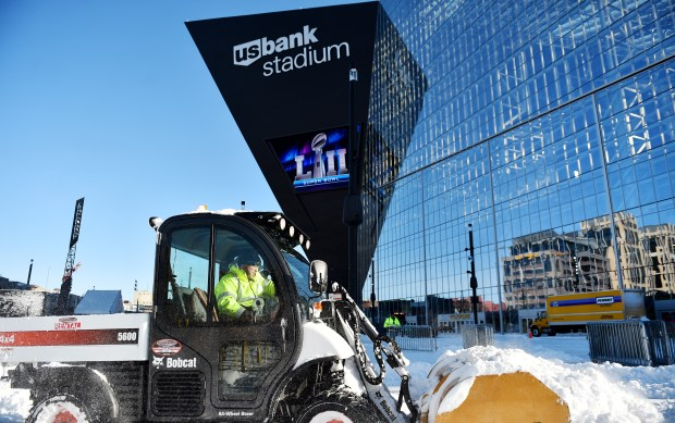 Dan Garrity of North St. Paul plows snow for Windsor Snow Removal Company outside U.S. Bank Stadium in Minneapolis on Tuesday, Jan 23, 2018. Garrity was one of dozens of workers helping clear the Super Bowl LII site and surrounding areas after a 12-inch snowfall Monday. (John Autey / Pioneer Press)