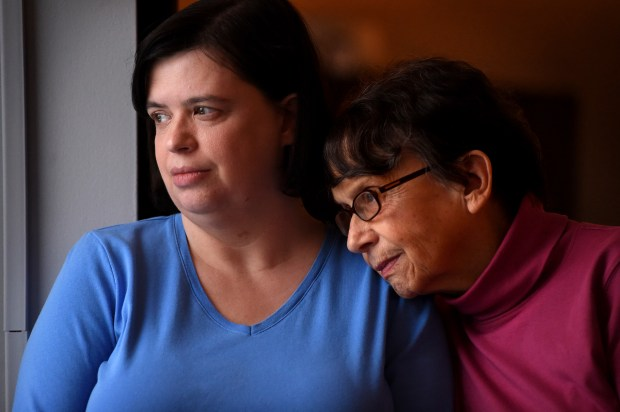 """""""I hate this time of year 'cause I always stare out the window; I'm always looking for her,"""" said Christine Swedell, left, with her mom, Kathy, on Dec. 20, 2017. Christine's sister and Kathy's daughter, Susan Swedell, disappeared in 1988 after leaving work and stopping at a gas station near her Lake Elmo home. (Jean Pieri / Pioneer Press)"""