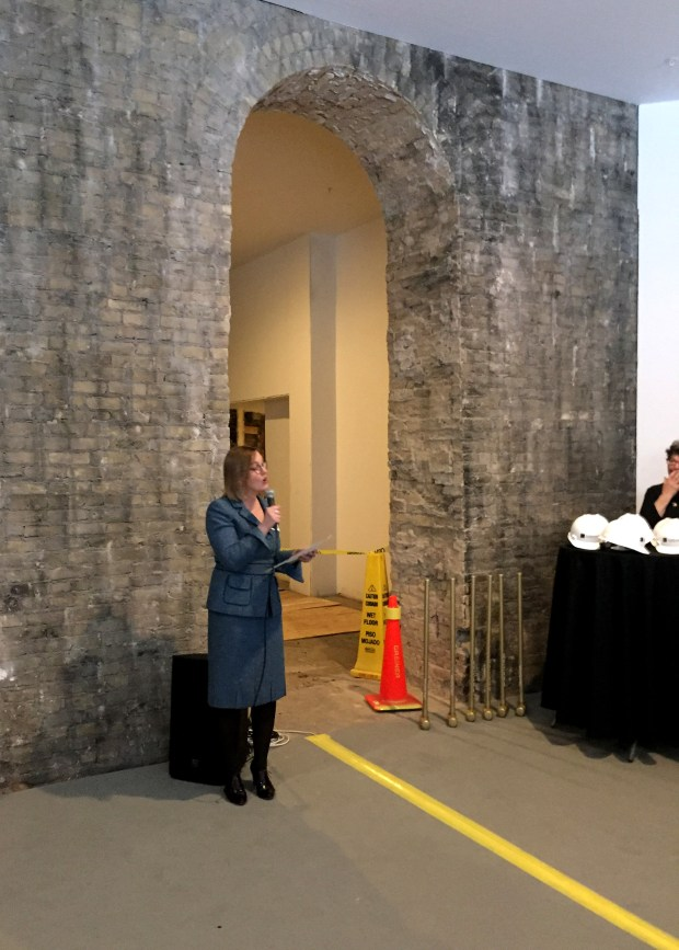 "Minnesota Museum of American Art executive director Kristin Makholm talks about the expansion of the St. Paul museum, known as ""The M,"" at a groundbreaking on Tuesday morning, Jan. 30, 2018. The M has begun a major expansion in downtown St. Paul's historic Pioneer Endicott building. The $12.5 million development project will expand the museum's public space to more than 20,000 square feet. The M's gallery currently occupies the corner of the Pioneer building at Fourth and Robert streets. Makholm is under an arch that will be part of the new museum entrance. The building was designed by famous St. Paul architect Cass Gilbert. (Kathy Berdan / Pioneer Press)"