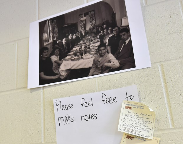 """A note describing where the photo was taken is attached added to a historical photo on a display as community members gather for """"An Afternoon of Reflection, Remembrance and Renewal of Friendships of Rondo"""" at the Hallie Q Brown Community Center in St. Paul on Monday, Jan. 15, 2018. (John Autey / Pioneer Press)"""