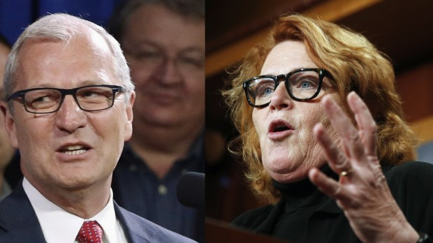 North Dakota state Rep. Kevin Cramer, left, and North Dakota Sen. Heidi Heitkamp