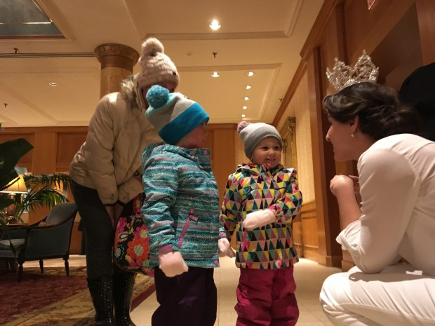 Jilla Nadimi, 2018 Queen of Snows of the St. Paul Winter Carnival, chats with 3-year-old twins Avery McKane (left) and Skylar McKane of Farmington in the lobby of the Saint Paul Hotel on Saturday, Jan. 27, 2018, the day after she was crowned. (Molly Guthrey / Pioneer Press)