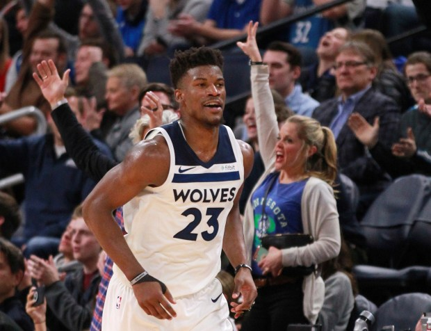 Minnesota Timberwolves forward Jimmy Butler runs down the court after hitting a 3--point basket against the Oklahoma City Thunder during the fourth quarter of an NBA basketball game Wednesday, Jan. 10, 2018, in Minneapolis. The Timberwolves defeated the Thunder 104-88. (AP Photo/Andy Clayton-King)