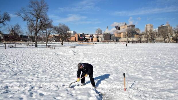 Tom, who gave no last name, from Hastings hunts for the Pioneer Press Treasure Hunt Medallion at Harriet Island Regional Park in St. Paul on Wednesday, Jan 31, 2018. He came to Harriet Island because it's where the big Winter Carnival Ice Castle was in 1992, he said. (John Autey / Pioneer Press)
