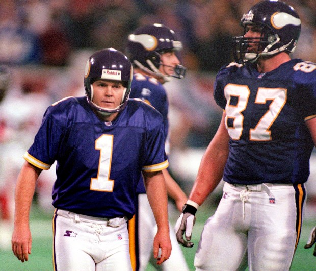 Minnesota Vikings kicker Gary Anderson (1) returns to the sideline after missing his first field goal of the season, a 38-yard attempt that missed to the left of the goal post, late in the fourth quarter of the NFC championship game against the Atlanta Falcons at the Metrodome in Minneapolis on Jan. 17, 1999. Anderson's missed kick sent the game into overtime, where Falcons kicker Morten Andersen kicked a 39-yard field goal to give Atlanta a 30-27 overtime win and their first Super Bowl berth. Behind Anderson is Vikings' holder Mitch Berger and at right is Hunter Goodwin. (John Doman / Pioneer Press)