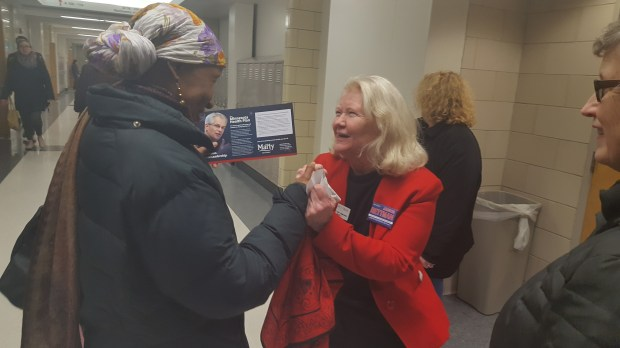 Ramsey County Commissioner Janice Rettman greets voters at Roseville Area High School on Tuesday, Feb. 6, 2018, during DFL precinct caucuses. Rettman, who has held her seat since 1997, faces two declared DFL challengers -- Trista Matas Castillo and Jennifer Nguyen. The county's District 3 endorsing convention will likely be held in early April. (Callie Schmidt / Pioneer Press)