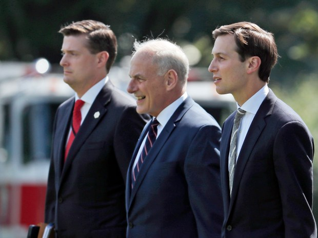 In this Aug. 4, 2017 photo, from left, White House Staff Secretary Rob Porter, White House Chief of Staff John Kelly, and White House senior adviser Jared Kushner walk to Marine One on the South Lawn of the White House in Washington. President Donald Trump was en route to Bedminster, N.J., for vacation.  White House staff secretary Porter has resigned following allegations of domestic abuse by his two ex-wives.   (AP Photo/Alex Brandon)