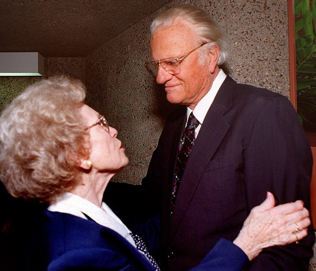 The Rev. Billy Graham and Helen Wilson greet each other after the funeral service for George M. Wilson, Associate Executive Vice President of the Billy Graham Evangelistic Association, at the First Baptist Church in downtown Minneapolis on Aug. 29, 1999. Graham came to pay his last respects to George McConnell Wilson, the man who, in essence, made Graham into a household name. Wilson was executive vice president of the Billy Graham Evangelical Association from its founding until his retirement in 1987. Helen and George Wilson were married for 59 years. (Scott Takushi / Pioneer Press)