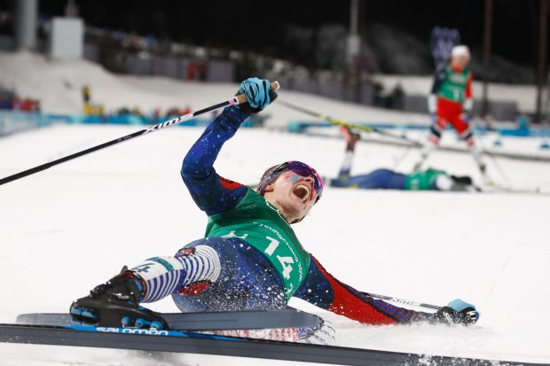 TOPSHOT - USA's Jessica Diggins reacts as she crosses the finish line to win team gold in the women's cross country team sprint free final at the Alpensia cross country ski centre during the Pyeongchang 2018 Winter Olympic Games on February 21, 2018 in Pyeongchang. / AFP PHOTO / Odd ANDERSEN (Photo credit should read ODD ANDERSEN/AFP/Getty Images)